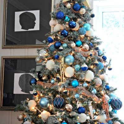 Decorations of Blue on White Christmas Tree